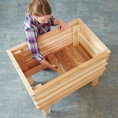 DIY Elevated planter - Planning to use this for strawberries - all I need to do is put some separation in between the slats to allow planting of strawberries thru the sides as well as on top.