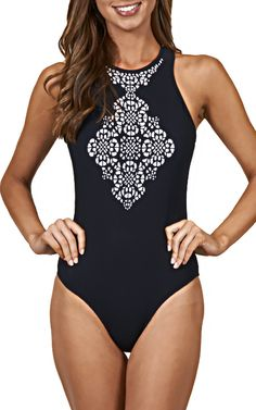 The open back design of this high neck one-piece swimsuit is sure to get you noticed. Both original and innovative, our new summer must-have. #JETSSwimwear