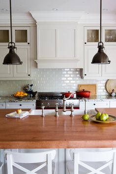 I love the subway tile backsplash and the butcher block.  The lights are perfect too. I'd prefer a stainless steel hood tho.
