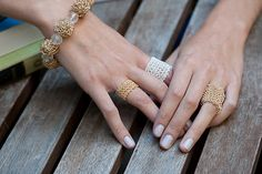 Ravelry: Knitted Jewelry pattern by Kristina McGowan.  Knitted rings, some made with wire, very cool