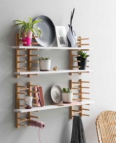 """9 Super IKEA Shelf Hacks Anyone Can Pull Off : """"This hack from VT Wonen starts out with a series of basic OSTBIT wood plate racks, which are mounted on the wall to become customizable shelving."""" This IKEA hack is somehow both weird and awesome. Ikea Shelf Hack, Ikea Closet Hack, Ikea Shelves, Ikea Storage, Extra Storage, Towel Storage, Storage Ideas, Ikea Rack, Storage Hacks"""