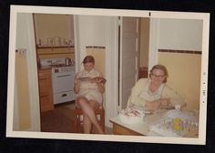 Antique Photograph Two Women in Retro Kitchen With Birthday Cakes Reading Paper