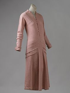 Particularly known for her innovative sportswear designs, Chanel used knits, such as jersey or knit tweed, to great advantage. While elegant in design, this dress slips over the head like the comfortable sweaters she first sold in Deauville. ca. 1924