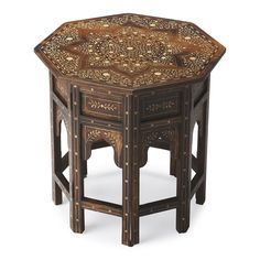 "This distinctive octagonal accent table will stylishly enhance your space. Featuring a Wood & Bone Inlay Finish, it is hand crafted from mango wood solids, bone. Dimensions: 20""W, 20""D, 20""H 35 lbs. M"