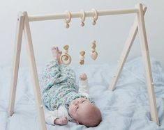 Wooden baby gym, no hangers, only frame + three wooden rings Baby Gym, Baby Play, Baby Activity Gym, Natural Nursery, Activity Centers, Breastfeeding Tips, Infant Activities, Baby Hacks, Wood