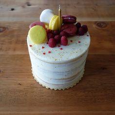 Lemon Raspberry Champagne cake; champagne cake, fresh raspberry preserves and lemon curd fillings, lemon swiss meringue buttercream, decorated with French macarons, fresh raspberries and disco dust [OC][3560x3560] : Baking Recipe: http://www.sprinklebakes.com/2013/09/raspberry-champagne-layer-cake-with.html