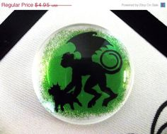 Wizard of Oz Flying Monkey with Toto 1 1/2 inch Pendant or Magnet