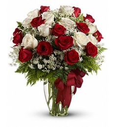 Absolutely ahhhh-some! You 're sure to score big points when you send her this gorgeous array of red and white roses in a sparkling Ming vase. Sure, it 's a little extravagant - but that 's what scoring big points is all about.Red and white roses - accented with Queen Anne 's lace and more - are delivered in a glass vase accented with a red satin ribbon.