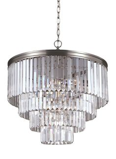 The dazzling and timeless Carondelet chandelier by Sea Gull Lighting features a dense cascade of faceted, linear glass crystals and delivers the ultimate sparkle without the fuss of traditional crystal. The sleek, contemporary silhouette adds drama and excitement to any room—without upstaging the beautiful furnishings and décor. Offered in Antique Brushed Nickel (shown) or Burnt Sienna finishes.