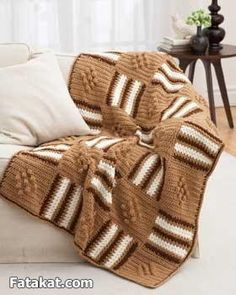 This blanket has squares of diamonds and stripes in a chunky-weight yarn. The monochromatic color scheme gives it a retro feel.