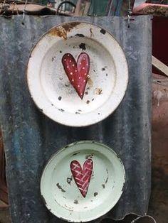 Hearts on old enamel plates