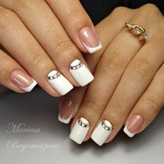 Diamond Studded White Nail Art Design. Diamonds go perfect with the white nail color and when they are placed in special order, they go from perfect to something extra-ordinary.