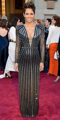Halle Berry at the 2013 Oscars. I love the structured look of this gown, but I wish it had no sleeves.