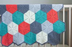 This free crochet afghan pattern uses hexagon blocks, so you can make a modern crochet baby blanket or customize the pattern to whatever size you'd like.