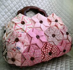 Hexagonal Folded Flower bag. Find the instructions for the flowers here:  http://www.youtube.com/watch?feature=player_embedded=FNfVUR9-RRo