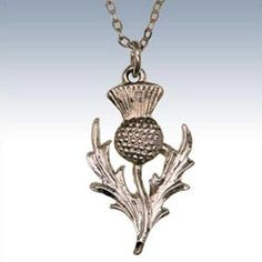 Celtic Pendant Thistle Pewter Celtic Pendant. Traditional thistle design. Size: Approx 25mm high.  Scotclans, a website dedicated to Scottish Clans , Scottish Tartans  and historical information.