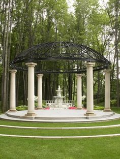 This large gazebo hangs over a fountain and has been placed in front of a garden. This is a decorative structure meant to bring depth and design to the fountain and garden. The gazebo makes the space feel more grand and important. Outdoor Gazebos, Backyard Gazebo, Pergola Patio, Pergola Kits, Backyard Ponds, Arbors, Pergola Ideas, Large Gazebo, Pavillion