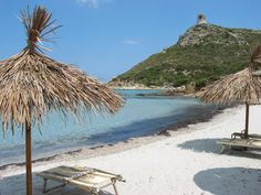 Two lounges, an umbrella and white sugary sand.  what more could one want? Villasimius, Sardinia, Italy