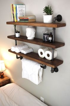 This towel bar/shelving unit combo is perfect for any bathroom. The industrial design allows it to be easily integrated into most interior designs or blended into a rustic setting. It is made entirely from recycled materials right here in our Florida studio. This unit also works well in the kitchen to keep those popular spices at arms reach and hang the dish rags for that occasional spill. The pantry and laundry room will also find this shelving unit to be a handy addition.  Height: 28 L...