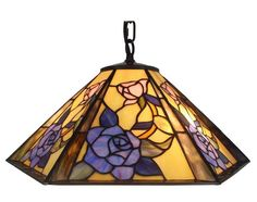 With an elegant metal base and floral pattern, this lamp honors the traditional look of the coveted lamps of the turn of the 20th century. hand-crafted using the same techniques that were developed by Louis Comfort Tiffany in the early 1900s, this beautiful Tiffany-style piece contains hand-cut pieces of stained glass, each wrapped in fine copper foil. Tiffany Style Hanging Lamp 18 In by Rustica House. #myRustica