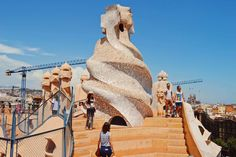 Enjoy Karl & Dean from #CoupleOfMen's exploration of La Pedrera-Casa Milà in summer. Blue sky, perfect colors and two love-birds over the rooftops of the Catalan city: bit.ly/VGSpain   #gaytravel #gayspain #VisitGaySpain #VisitGayBarcelona #RainbowBarcelona #VisitBarcelona #LaPedrera