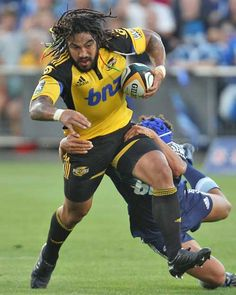 The Hurricanes' Ma'a Nonu takes on the Blues' defence