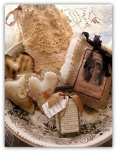Burlap and lace.. and of course gotta have those hearts!  use Graphics Fairy to print out cute things and sew onto little square hanging pillows!