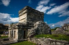 Tulum. I have been here, but it is, in my opinion, one of the most beautiful of Mayan ruins. It sits on a low hill that drops off to a white beach at the edge of the most beautiful azure sea. Some of the drawings in the various buildings still retain some of their brilliant colors.