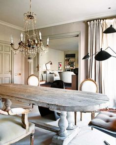 oversized dining room table made from reclaimed wood and upcycled architectural wood turned legs.