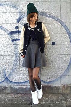 I like the reeboks, skirt, and lettermen's jacket all together.