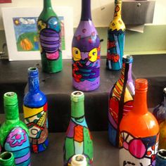 Students used wine bottles to paint Romero Britto inspired art. Paint with white paint first, sketch design with pencil, paint with tempera, outline once dry with jumbo permanent marker, and seal with acrylic gloss! So much fun and looks beautiful when complete :)
