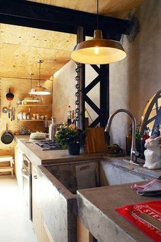 My girlfriend will NEVER go for this, but oh well. Concrete countertops with a deep farmhouse sink would be awesome.