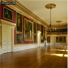 The ballroom at Goodwood House in West Sussex England was done Regency style.