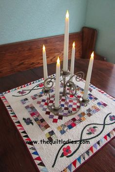Little quilt as a table topper, by The Quilt Ladies