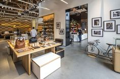Known for its luxe leather goods and watches, this 4,484 sf Shinola store also offers two  other exciting concepts within its space: 1) Saved Tattoo is located in the back of Shinola helmed by renowned NYC tattoo artist Scott Campbell and 2) Di Alba, an Italian inspired cafe.