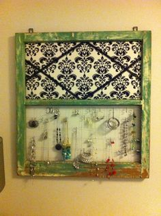 This is the old window I found at my uncles. I sanded it put some wire in the bottom and cork board covered with fabric on the top and waaallla a decorative jewelry holder.