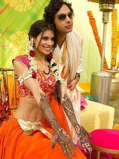 Kunal Nayyar (Raj) with his wife Neha Kapur at their big fat truly Indian wedding!  Mehendi outfit inspiration