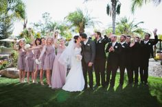 Bride and Groom Kiss with Bridal Party