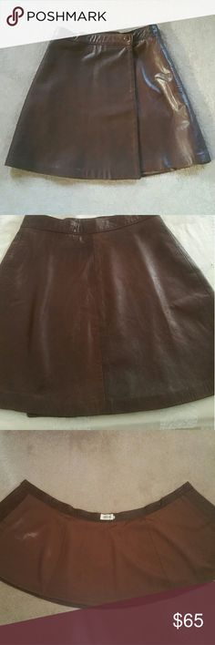 """Italian Leather Wrap Skirt! EUC! Vintage since the boutique in Soho closed in 2009. This is unbelievably soft and lightweight , almost snakeskin like leather. Waist is 25"""" length is 14.5"""" . Perfect condition.  No discoloration although pics look that way due to reflection only. variazioni Skirts Mini"""