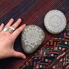 https://flic.kr/p/p4f9am | Painted Cobbles | These are the biggest pebbles I've painted which are technically cobbles. The one I'm holding was painted in 2012, the other just now.