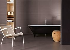 Neutral tones with subtle texture help warm a space. Fade tiles are from Surface.