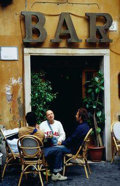 People sitting at bar on Vicolo del Cinque in Trastevere.