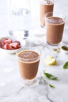 Sprouted Strawberry Basil Lemonade Green Smoothie - Looking for delicious healthy strawberry lemonade smoothies? This raw vegan green smoothie contains romaine lettuce and sprouts. And you would never know!