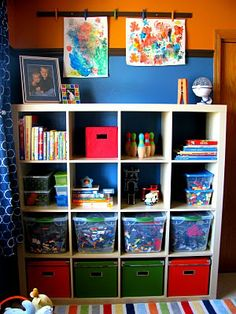 Kids' Storage Space. This image is from IHeart Organizing. I'm assuming this uses the IKEA Expedit bookcase.