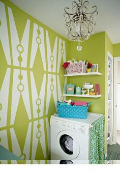 maybe I'd like to do laundry with a room like this! LOVE the clothes pin clips on the wall!