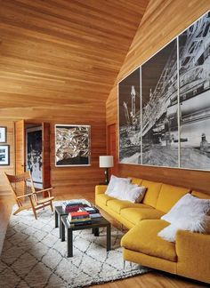 Architect Peter Marino's Rocky Mountain Ski Retreat. PHOTOGRAPHY BY  ROGER DAVIES.   An Anselm Reyle foil painting joins a Vera Lutter photo triptych in the den, which is furnished with a B&B Italia sectional sofa accented with faux-fur pillows, a Hans Wegner armchair, Marino-designed bronze tables, and a Moroccan Berber carpet.