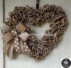 This is a romantic heart shaped burlap wreath with pearl edges perfect for a wedding or bridal shower, a baby shower, spring, summer, year round, a housewarming gift, Valentines Day. There are so many uses for this elegant wreath. It measures approximately 20. See more items http://www.etsy.com/shop/mrschristmasworkshop