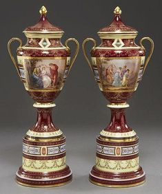Pair Royal Vienna style porcelain covered urns.
