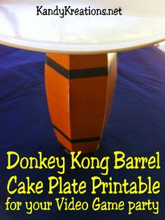 Place your desserts on this printable Donkey Kong barrel cake plate for a fun addition to your Video game or Arcade game party.  Printable barrel is easy to make and brings a little arcade fun to the party.