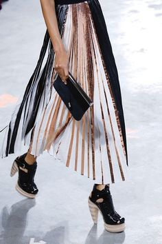 Black white and gold pleated skirt